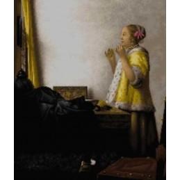Mujer con collar de perlas